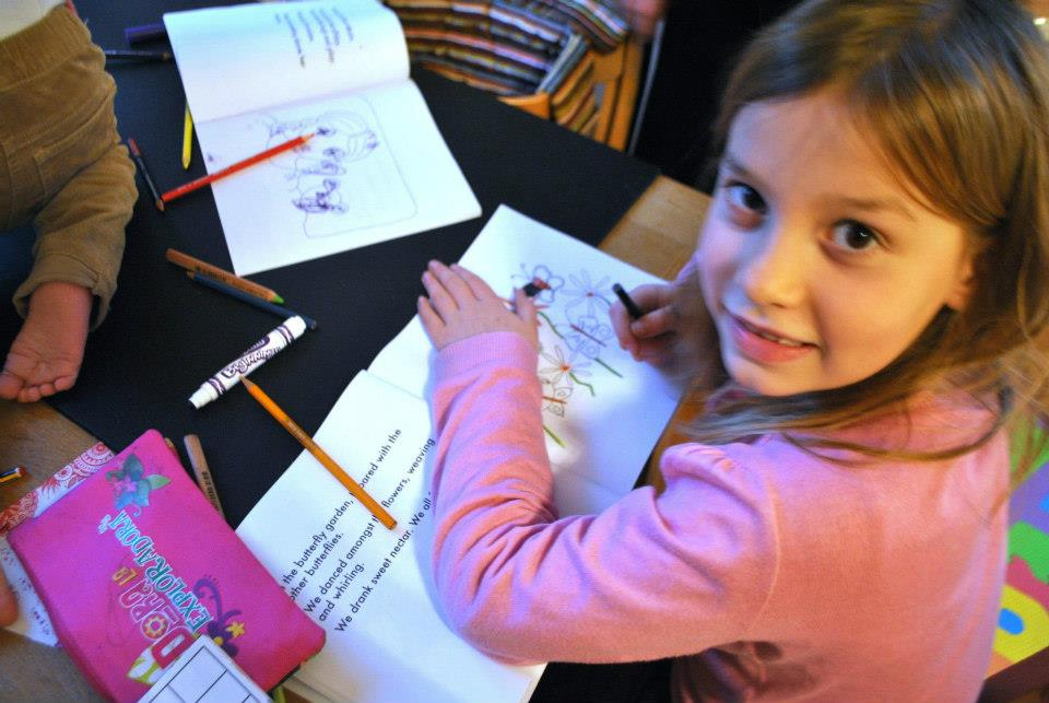Butterfly Fans Charlotte and Darcy colouring in their books.